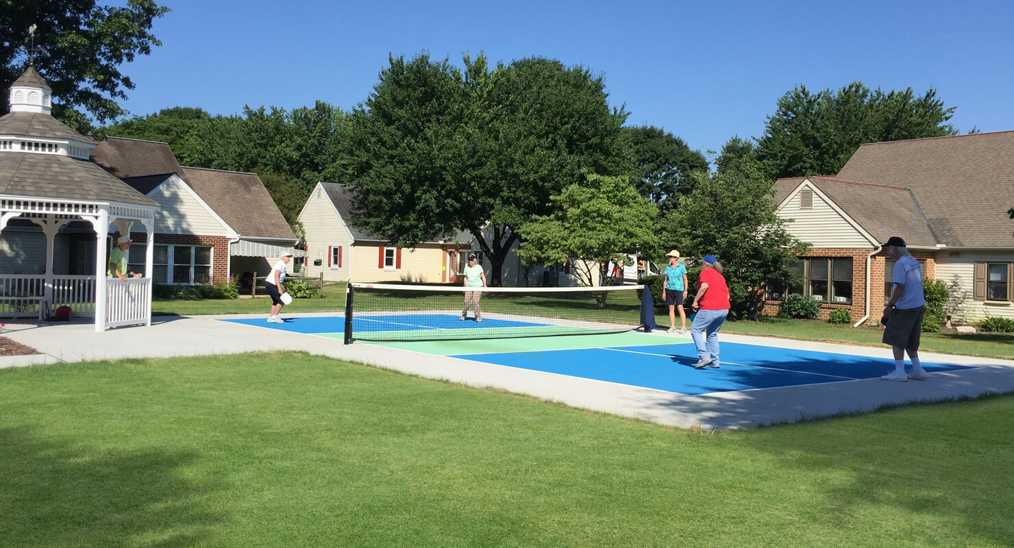 Residents play Pickleball at Homestead Village