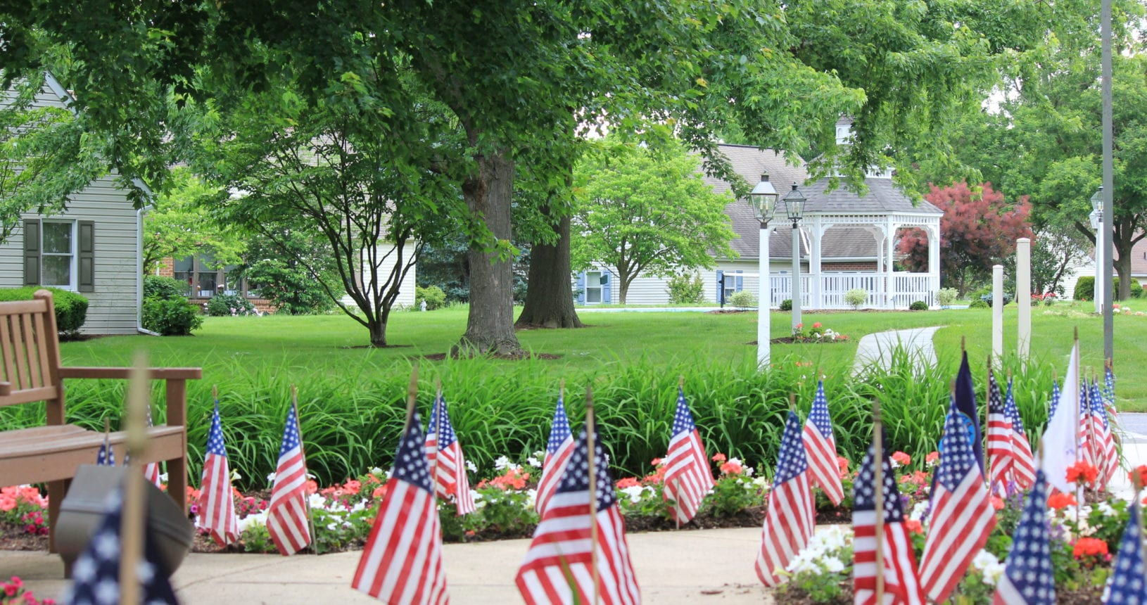 Flags and a Gazebo at the Front Entrance of the Homestead Village Apartment Building