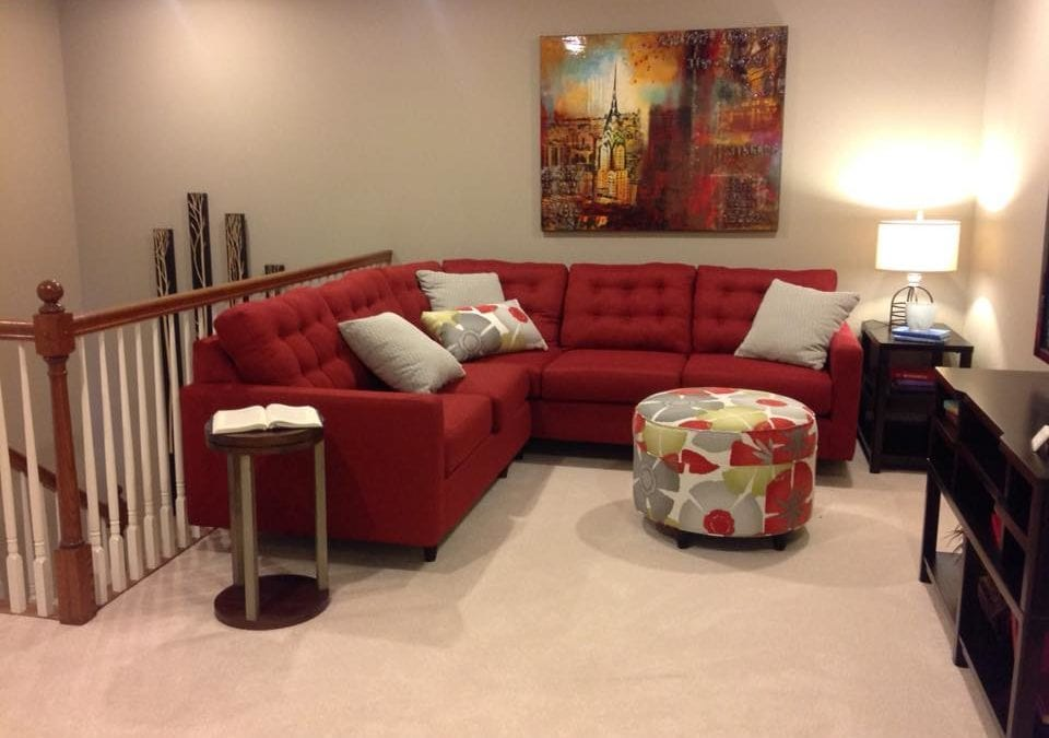 Cozy red couch in loft of Farmstead Home