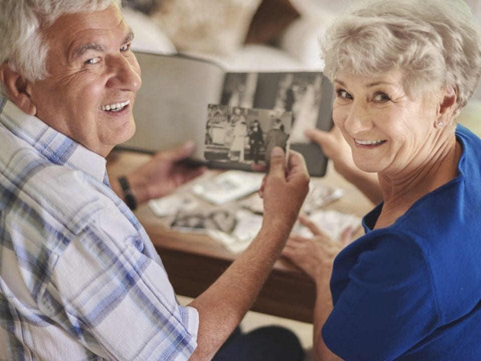 Couple enjoys looking at old photos and reliving memories together