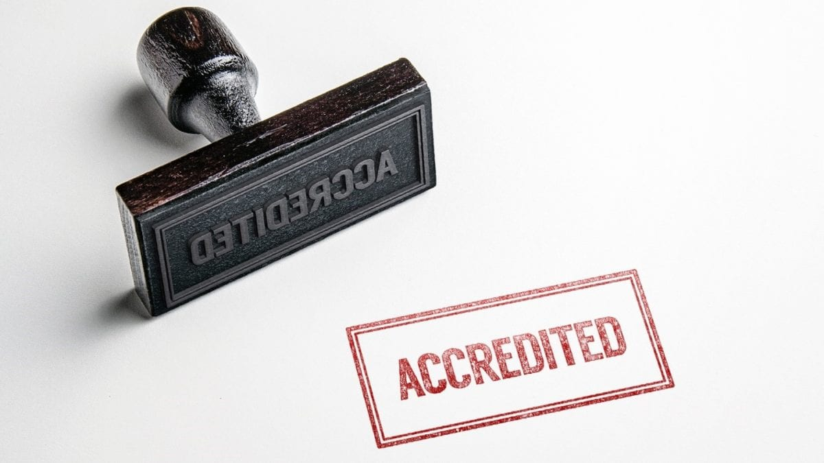 Accreditation stamp signaling quality