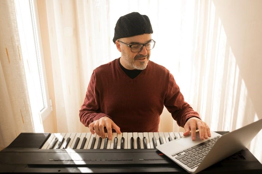 musician on keyboard