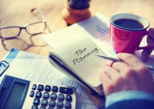 man planning taxes